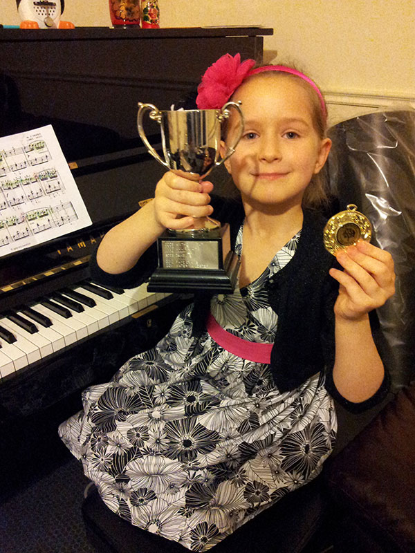 Annie Marie Popov With Trophy From Woodley Festival