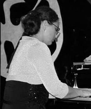 Piano Teacher - Nadia began