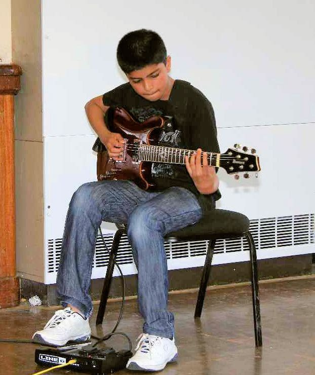 Vijay Playing Guitar